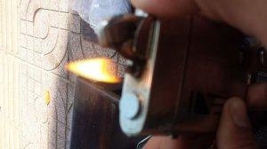Bán 1 cái bật lửa luôn cả hợp đựng thuốc