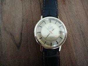 Cần bán đồng hồ omega bát quái vàng đút 18k