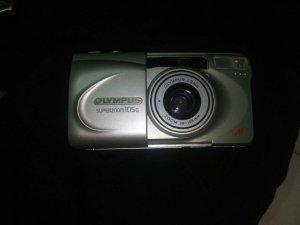 May anh Olympus Lens105g