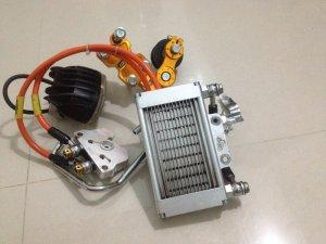 Két nhớt, tăng sên tự động, đèn trợ sáng L2, ống xăng kiểng, bình lọc xăng thủy tinh...