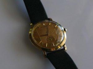 Đồng hồ vàng 14k Modova autumatic.