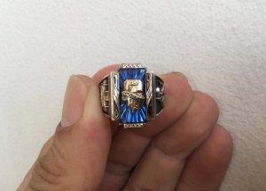 Nhẫn vàng bá cấm hột xanh tia...