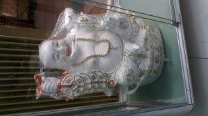 Tượng gốm Phật Di Lặc cầm gậy như ý và đồng tiền
