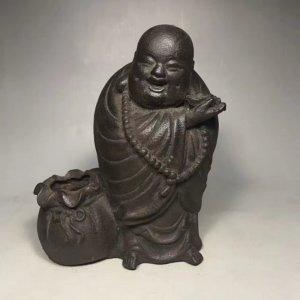 Tượng Phật cười bằng sắt...