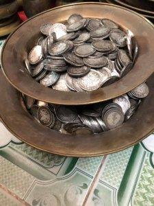 Về được ít đồng xu đồng tráng...