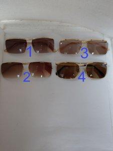 Có 4 cái kính cổ mạ vàng bọc...