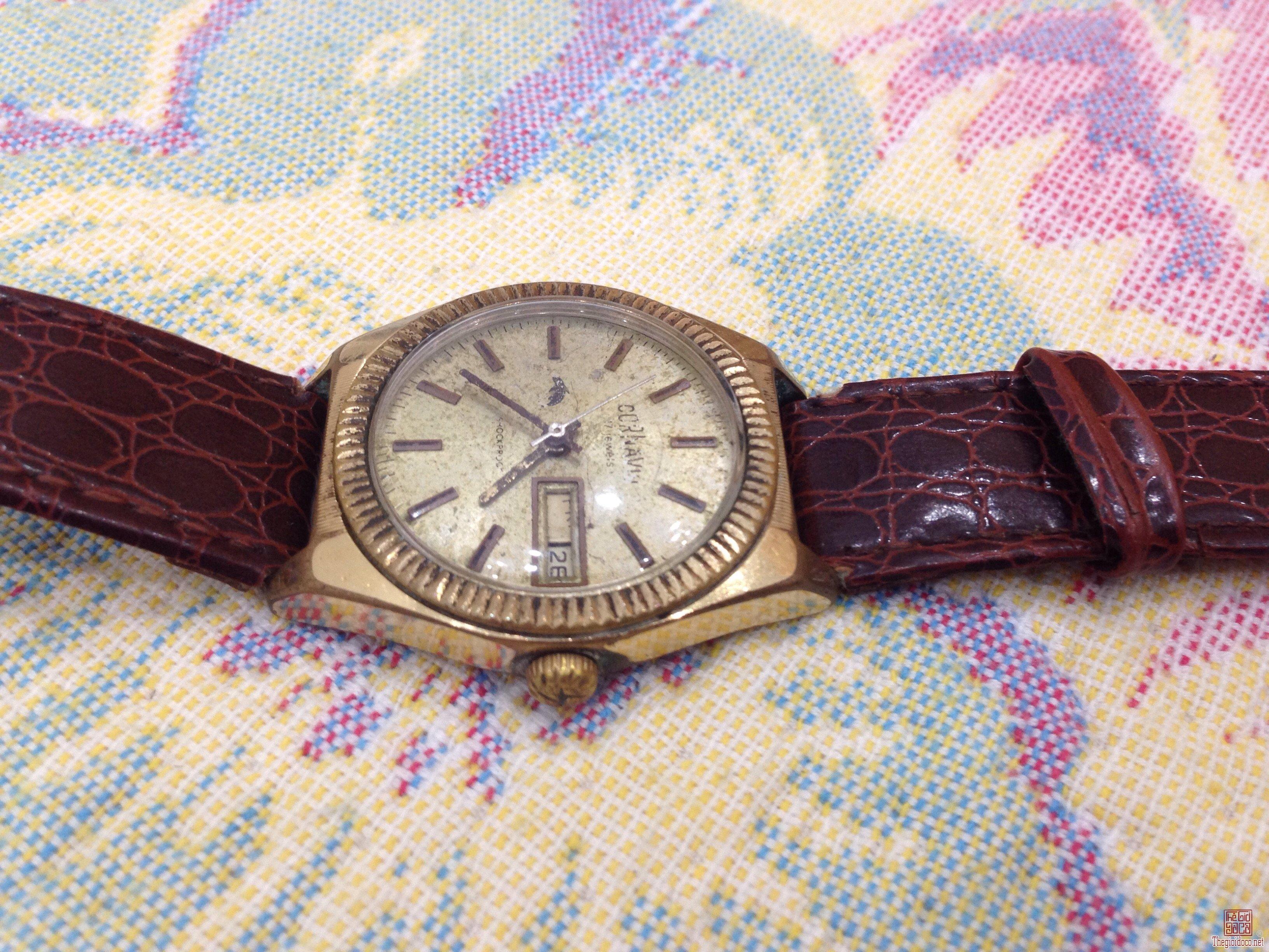Đồng hồ Cỏnavin cổ liên xô vỏ lắc kê vàng 22k