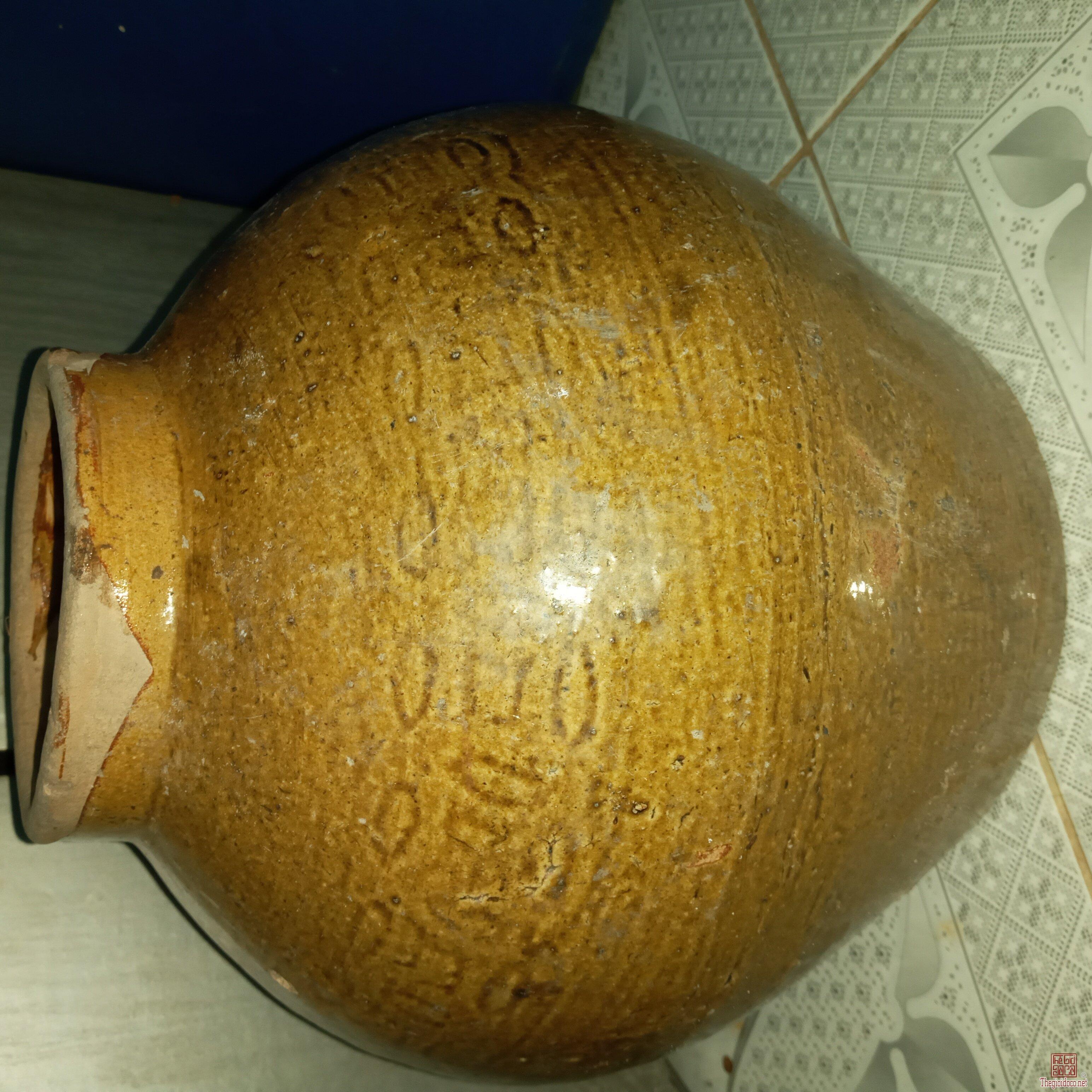 Giao lưu:Chum đồng tiền xưa.Chiều Cao 30Cm.Vòng bụng 92cm.Lành