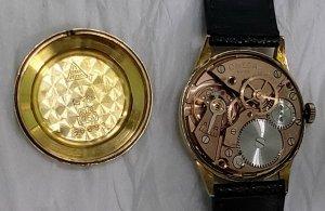 Đồng hồ xưa lên dây OMEGA 18K...