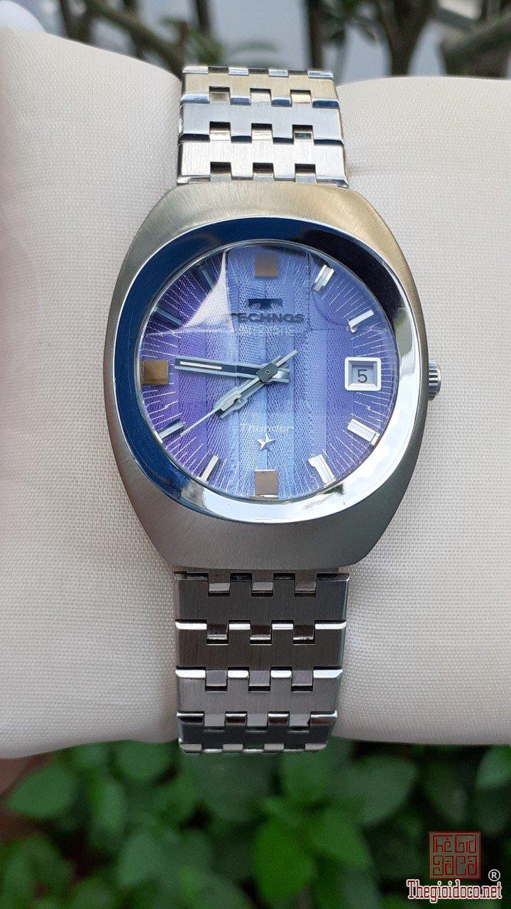 Đồng hồ Technos mặt tím kính vát zin trọn bộ